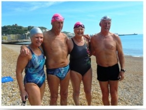 Barracuda Aquaholics team of Kathy, Roger, Sue & Tom on the beach at Dover prior to 2012 relay swim