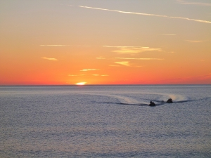 Safety boats arriving at sunrise