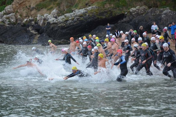 Swimmers take to the water at the start of the annual RNLI Myrtleville to Church Bay Swim recently. Picture: Howard Crowdy