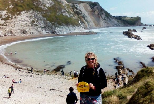 Siobhan Russell with her holiday hat at Man O'War Bay, Lulworth Cove, England.