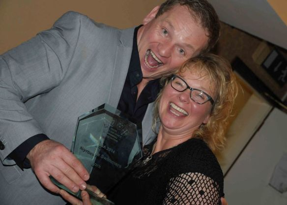 Ger Kennedy tries to take it back but Siobhan has both hands on the award.
