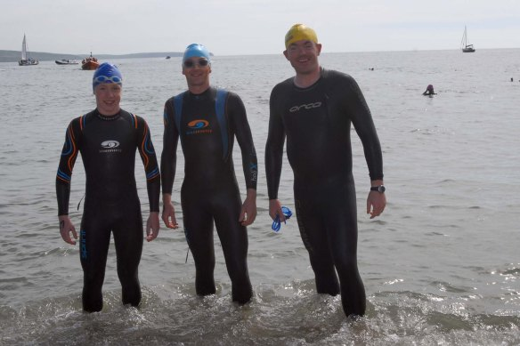 Dipping their feet into the ocean at the start of the Myrteville to Church Bay RNLI Sea Swim were Chris Mintern, Fermoy with Trevor Woods, Ballincollig and Padraig Maguire from Douglas (pic Howard Crowdy)