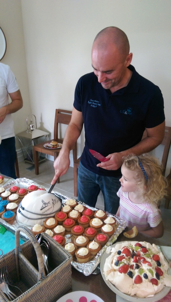 Trevor with daughter, Cliodhna supervising the cake cutting.